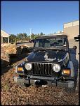 2004 Jeep Wrangler sport-e948043a-5a18-4667-b38b-16b1ed62b228